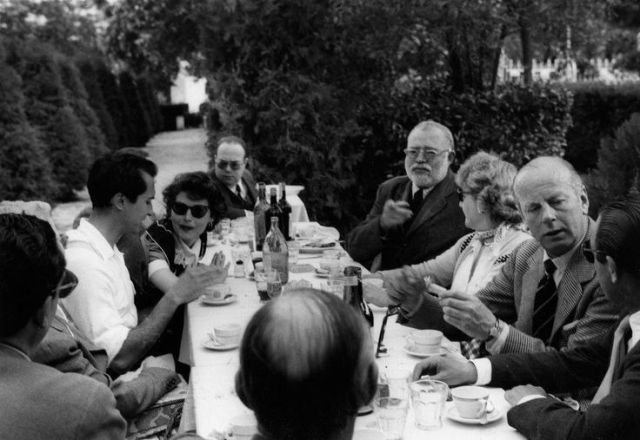 Ernest Hemingway at lunch with Ava Gardner, bullfighter Luis Miguel Dominguin and others at lunch in Costa del Sol, Andalusia, Spain